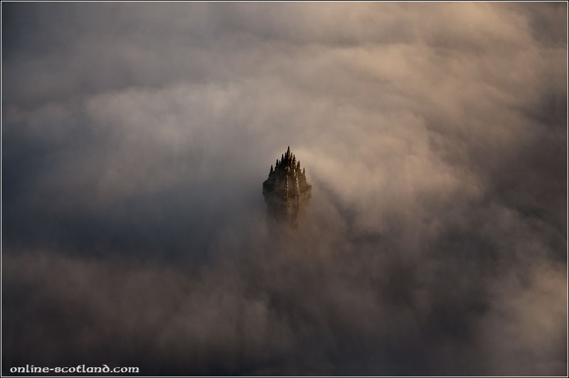 The Wallace Monument peaking through low cloud